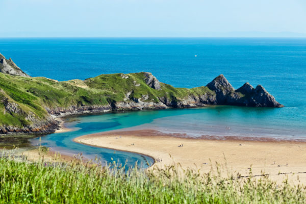 A beach in Wales, one of July's unexpected destinations.