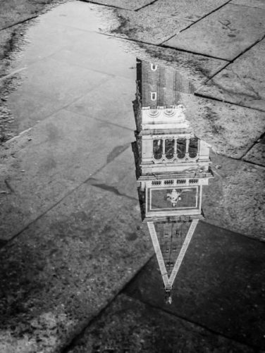 A reflection of a Venice bell tower