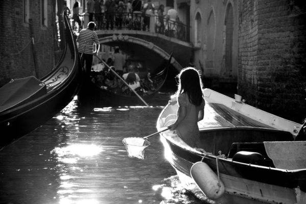 A young girl on a gondola in Venice