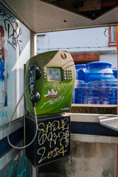 A payphone covered in graffiti in Chiang Mai.