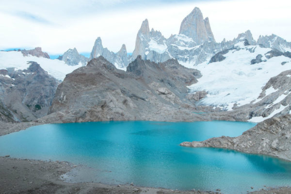 A blue lake at the top of a mountain