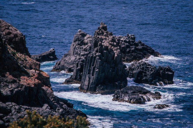 Rock formations seen off the coast of Bruny Island in Tasmania, Australia