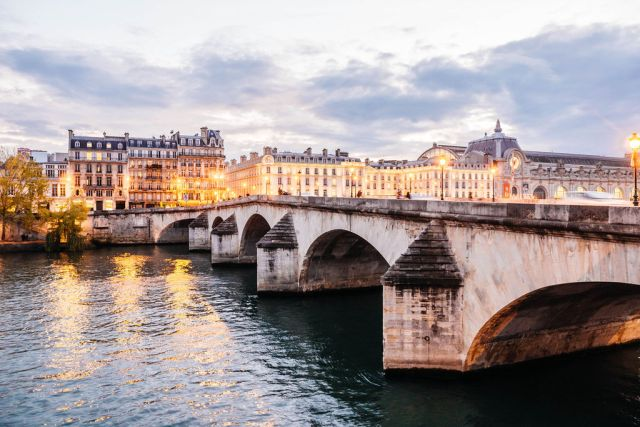 A bridge spanning a across a river in Europe