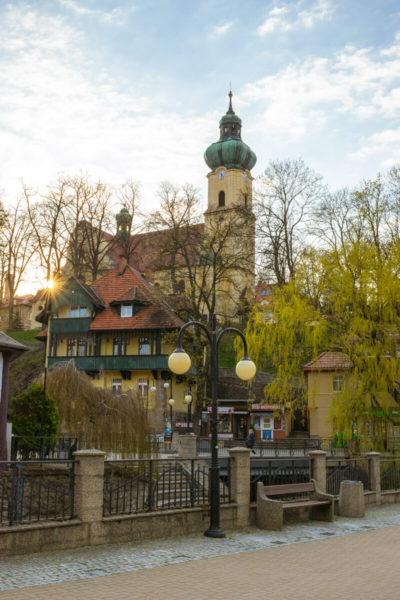 a riverside scene in poland's polanica health resort