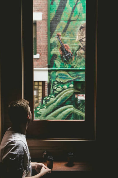 Cafe window with view of Melbourne street art