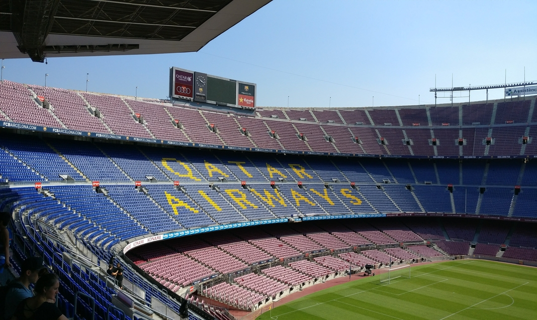 an empty soccer stadium in the daytime