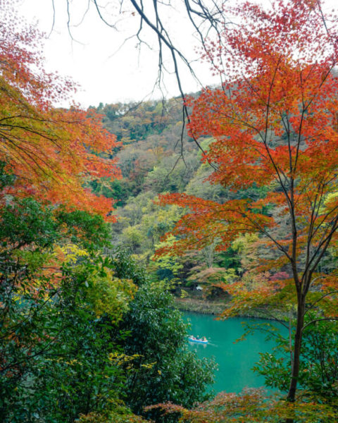 Autumn colored forests and blue lake, Arashiyama, Japan