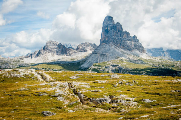 Fields and mountains in the Dolomites