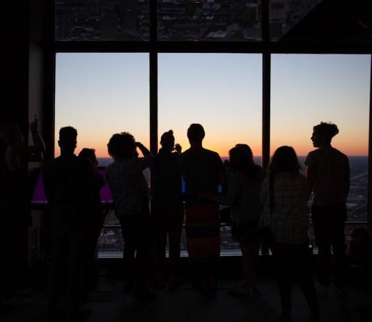 people watching sunset