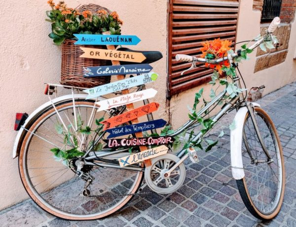 artwork made of bicycle and roadsigns