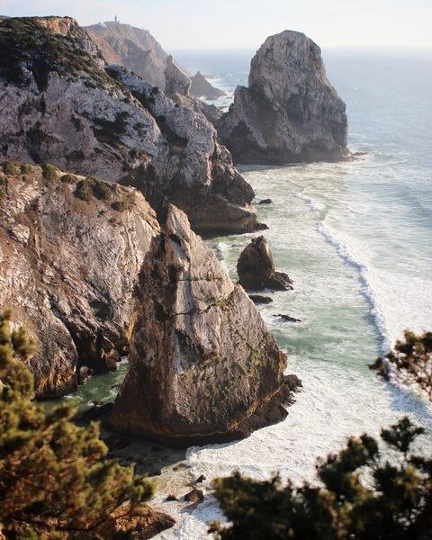 tall jagged rocks on sunny coastline
