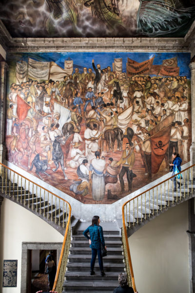 mural atop staircase in mexican castle