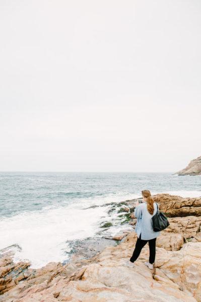 woman standing on coastline