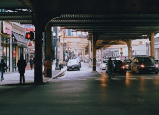 street under a subway platform in busy city