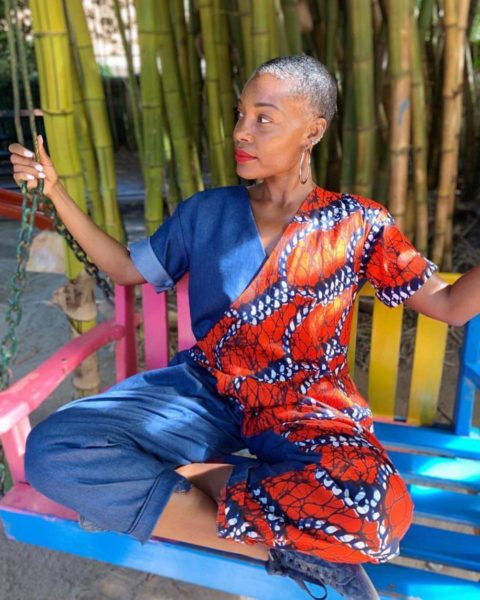 woman in colorful clothing on blue swing