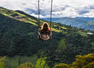 woman on a swing in ecuador mountains