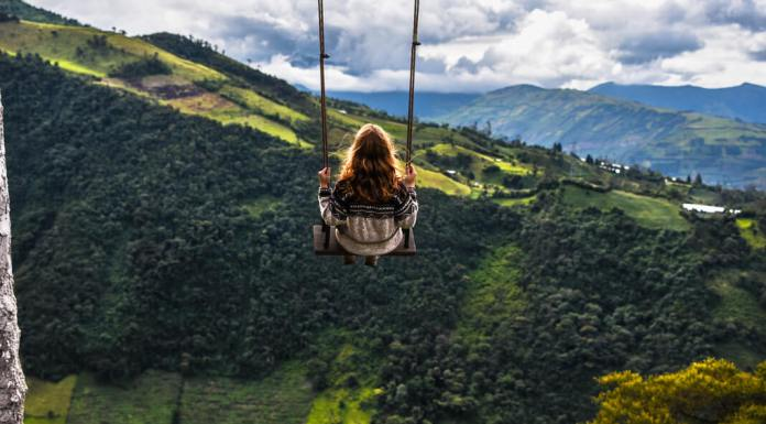 woman on a swing in ecuador mountains