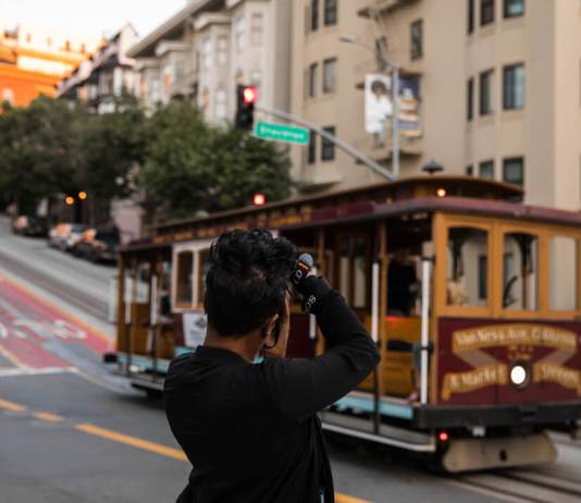 black photographer looking at streetcar