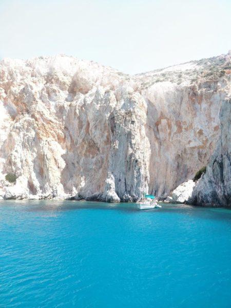 blue lagoon under cliff face