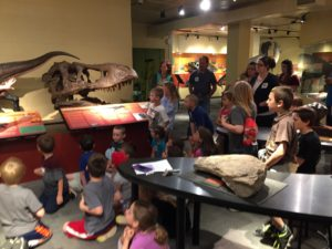 Students looking at dinosaur fossils