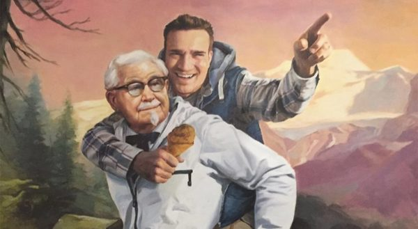 Mike Edgette getting a piggy back ride from Colonel Sanders.