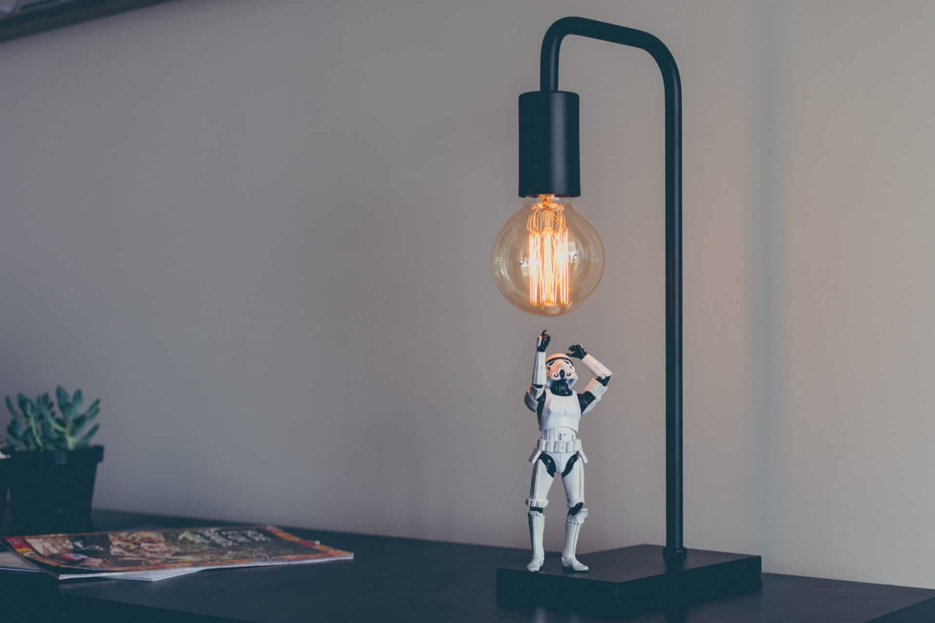picture of robot and lightbulb for Real Estate News for Investors Podcast Episode #325