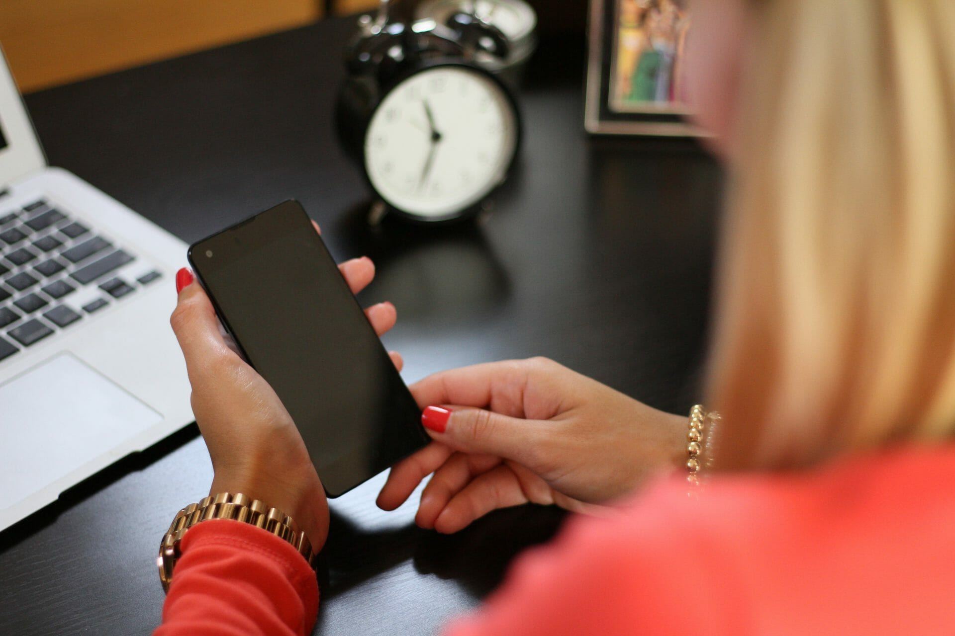 picture of woman and phone for Real Estate news for Investors Podcast #420