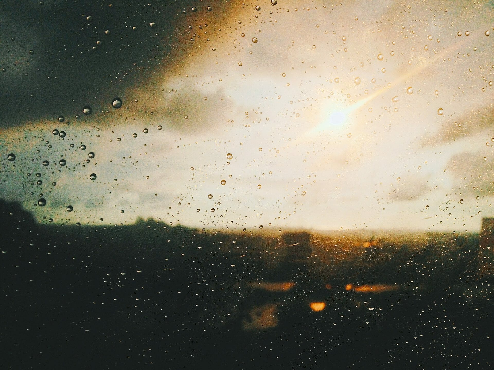 picture of sun through rain splattered window for Real Estate News for Investors Podcast Episode #433