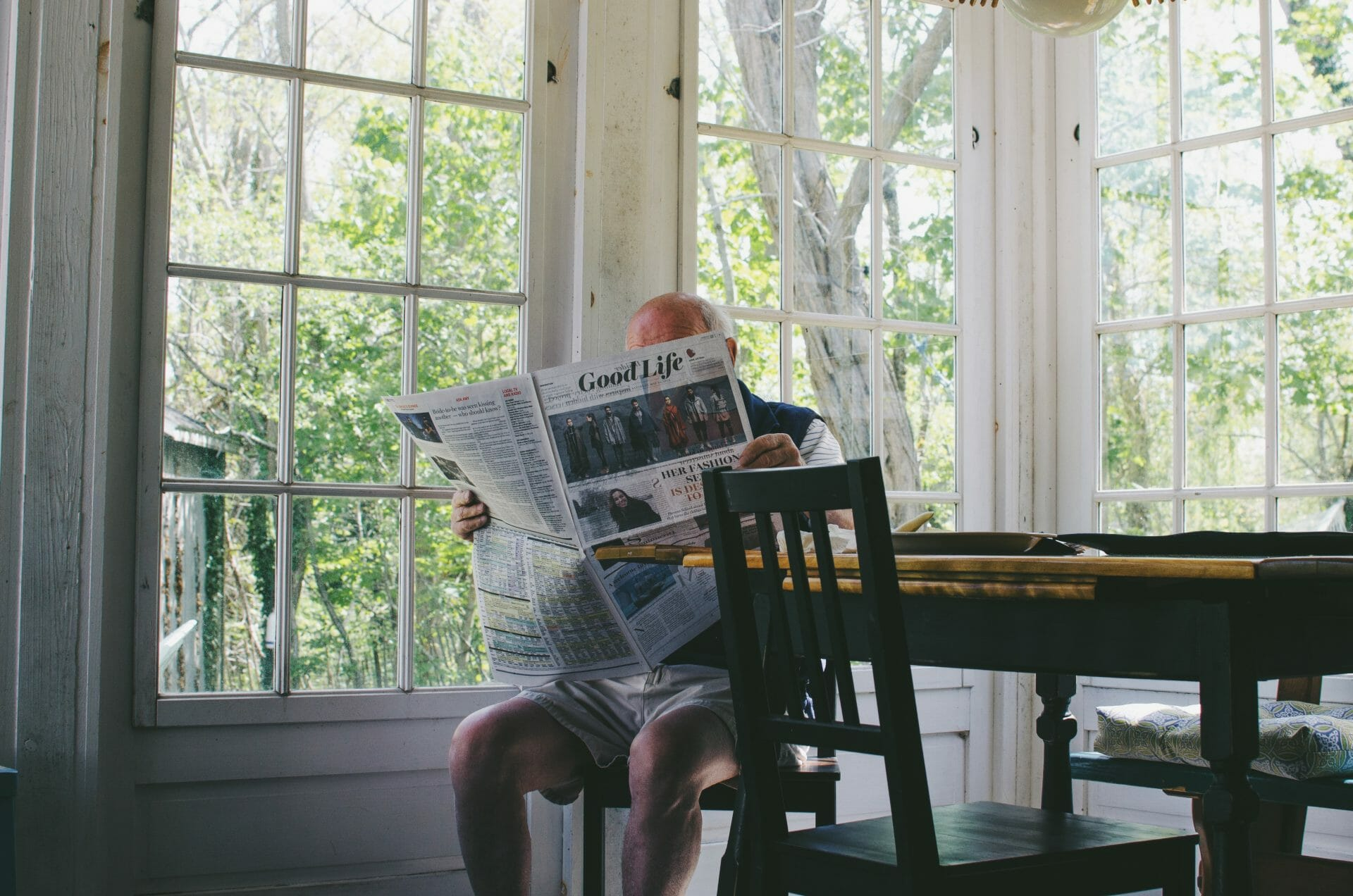 Picture of A Man Reading a Paper for Real Estate News for Investors Podcast Episode #616