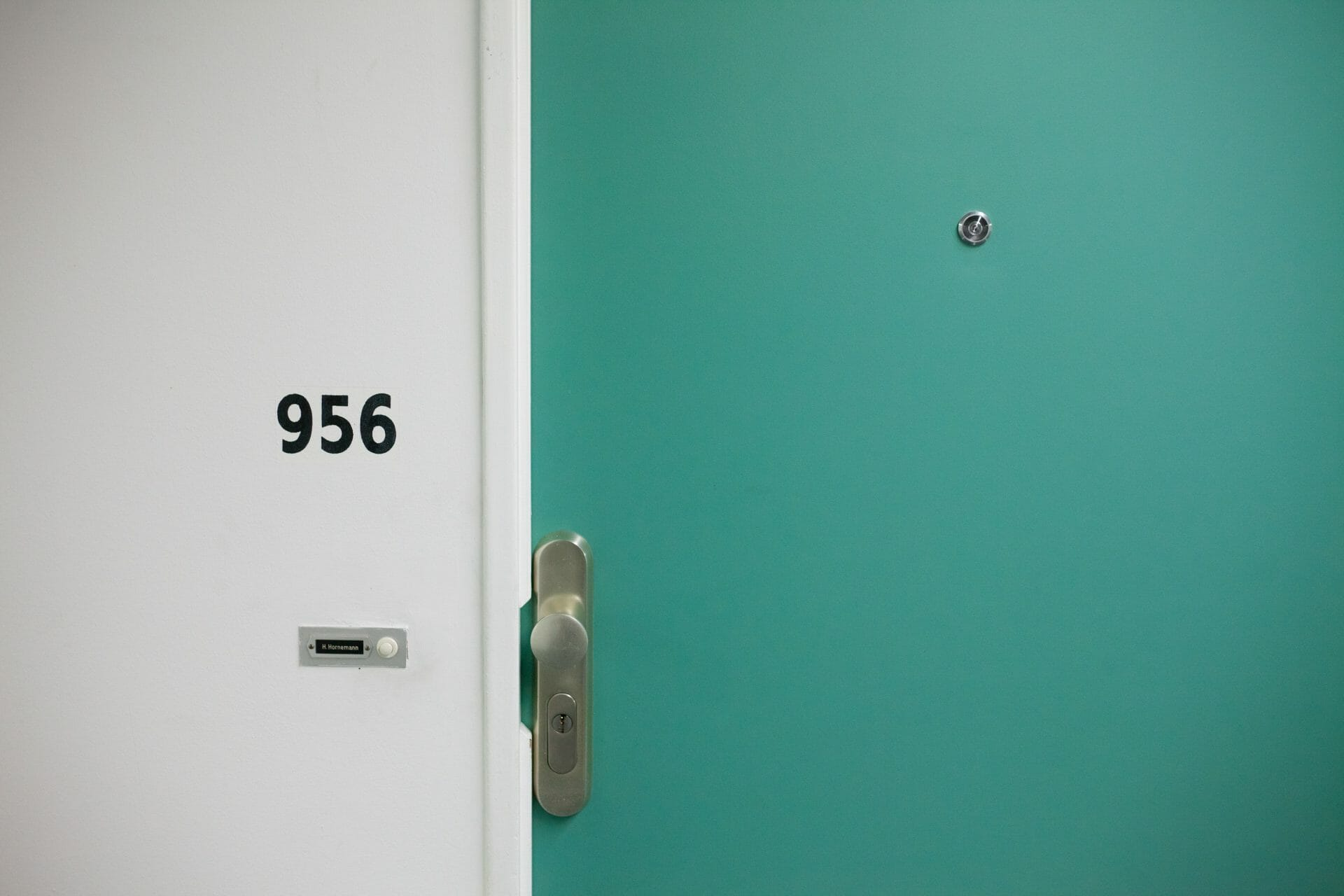 Picture of Apartment Door and number for Real Estate News for Investors Podcast Episode #710