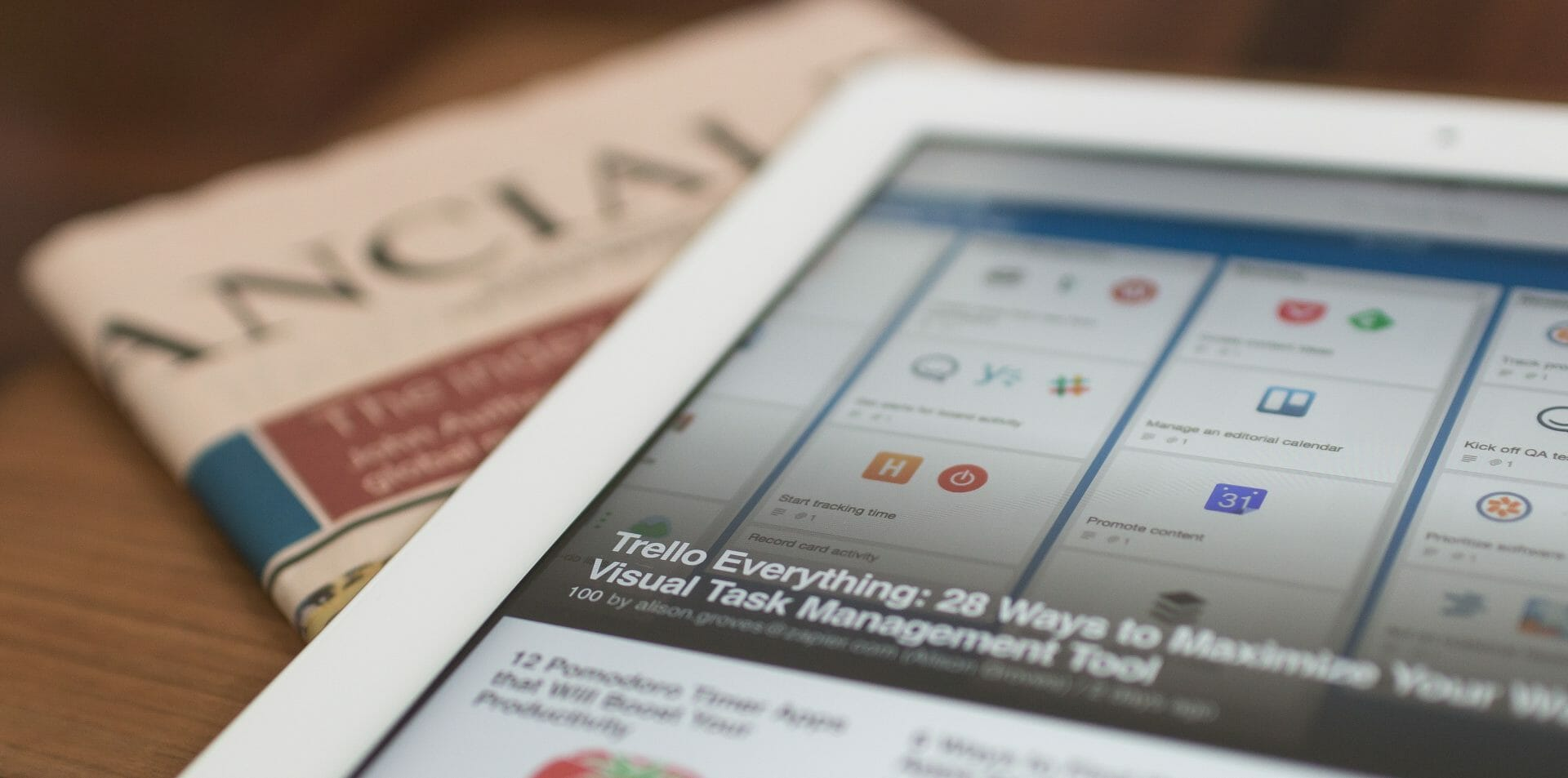 Picture of ipad and newspaper for Real Estate News for Investors Podcast Episode #728
