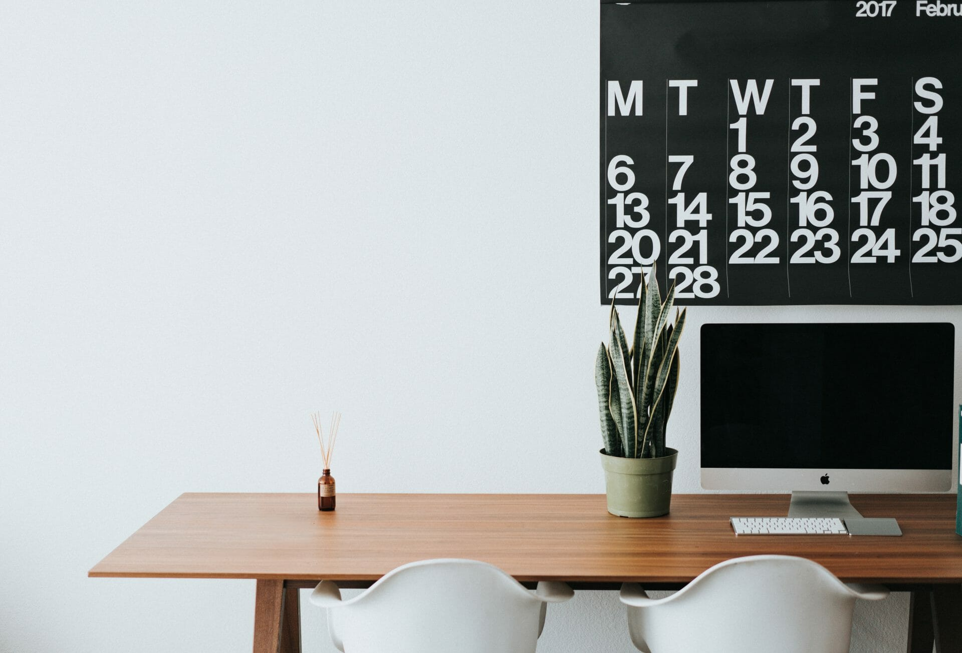 Picture of desk, plant and calendar for Real Estate News for Investors Podcast Episode #736