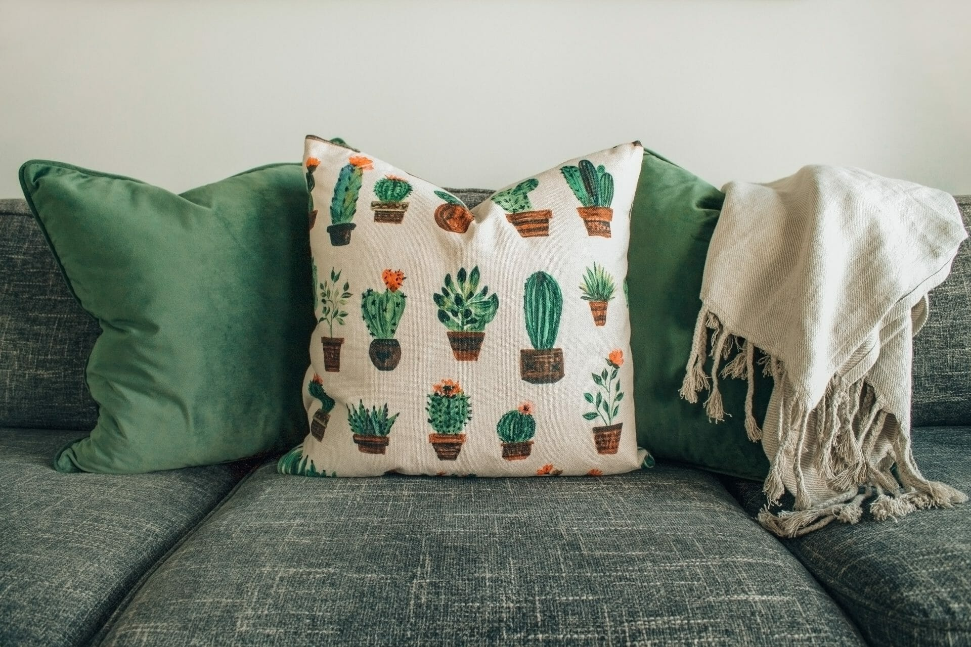 Picture of sofa with cactus pillow for Real Estate News for Investors Podcast Episode #791