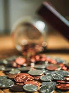 Picture of coins on table for Real Estate News for Investors Podcast Episode #796
