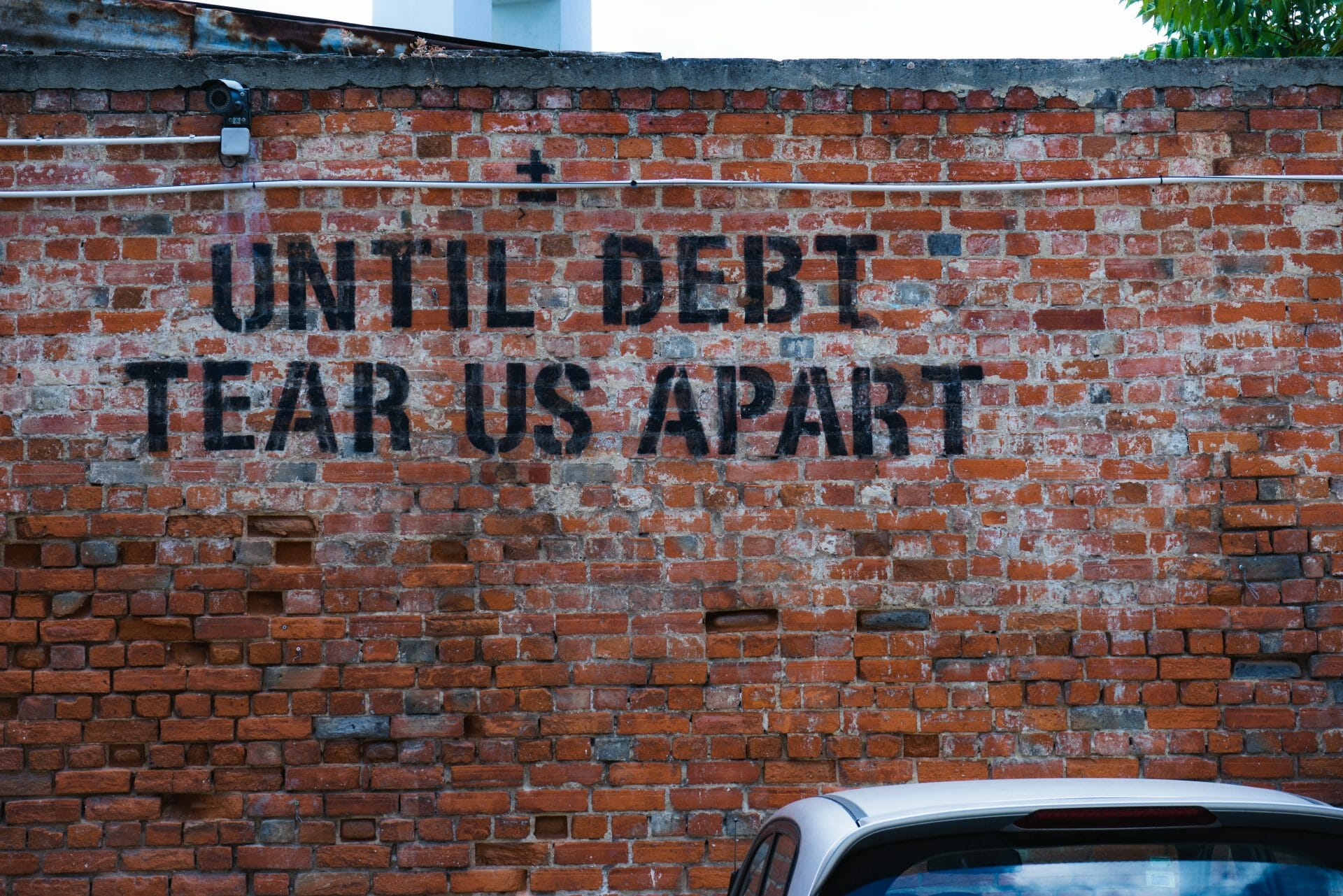 """Picture of """"Until Debt Tear Us Apart"""" Graffiti for Real Wealth Show Podcast Episode #692"""