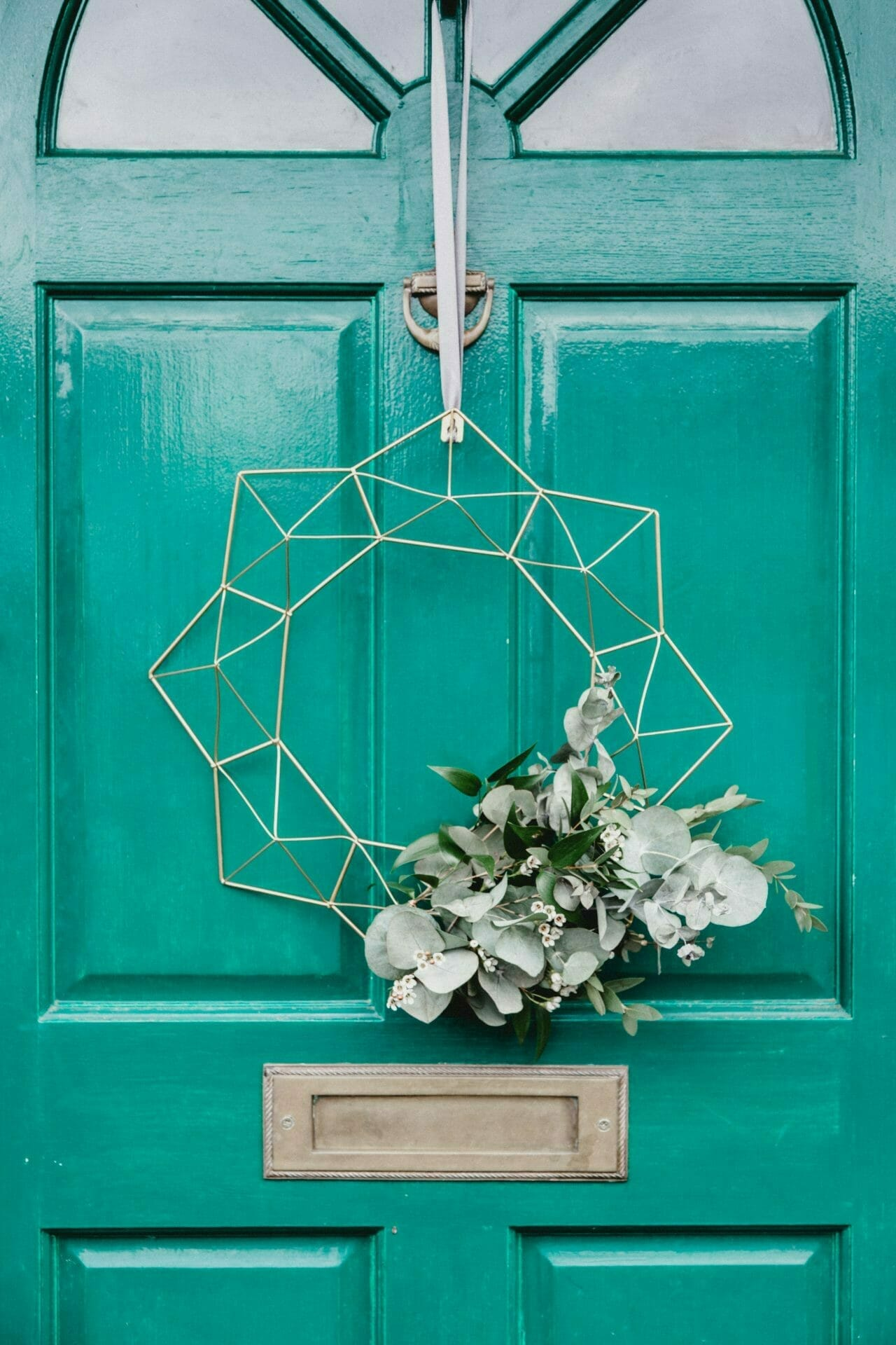 Picture of front door with star wreath for Real Wealth Show Podcast Episode #696