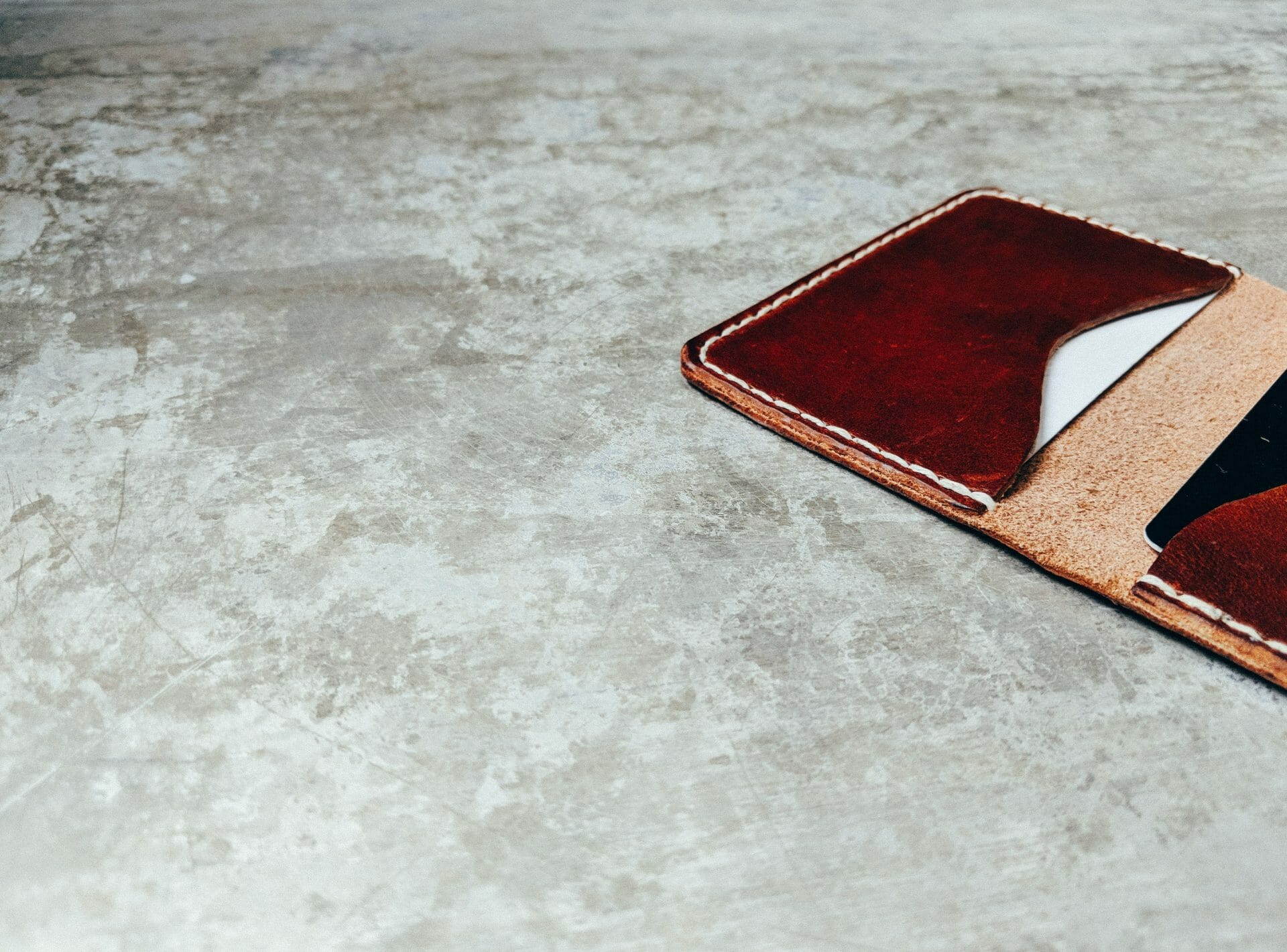 Picture of wallet on table for Real Wealth Show Podcast Episode #702