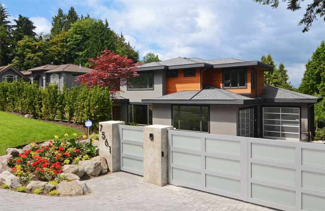 """CUSTOM MODERN & QUALITY NEW built home with VIEWS from the 2nd floor. Never lived in! Open concept home w/6 bedrooms; all bedrooms have ensuites! Impressive open great room looking out to large heated covered deck which looks to a quiet, private, level backyard! Very cool looking, floating, """"Hollywood"""" stairs in center of the main floor separates great & dining room. Contemporary kitchen has large island w/hidden appl. White cabinets/drawers give a very clean, modem look! High-end appl: Thermador fridge, Dacor wall oven/stove top. 2 D/W+Wok kitchen. Throughout engineered H/W. & radiant heat. Master bed has a VIEW, F/P, walk-in closet w/custom built-ins, spa-like ensuite w/large shower & free standing tub! Privacy blinds throughout. Check Agent's website for FLOOR PLAN & additional photos"""
