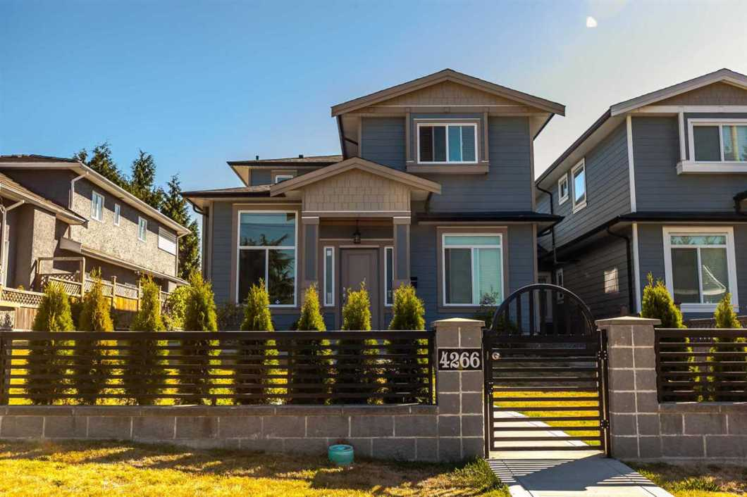 Quality built 2200 sqft half duplex in one of the best locations in Brnaby Hospital area. Custom built home by experienced builder featuring 3 beds upstairs and kitchen. Living rm and den on main floors plus 2 beds suit with separate entrance. And also have a detached double car garage. Call for viewing.