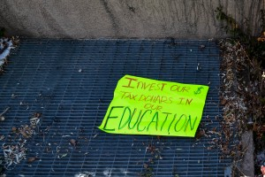 A demonstration sign outside the New Mexico State Capitol building.