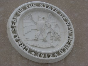 The seal of New Mexico outside the state capitol building. Photo by Matthew Reichbach