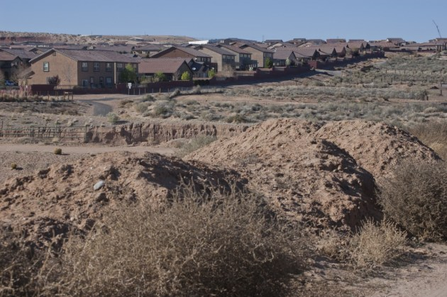 "However, infrastructure needs in rapid growth areas like Rio Rancho remain intense, particularly when it comes to flood control. The Rio Rancho Observer's editorial board wrote in 2013 that the city's ""problems after severe stormy weather aren't going to go away soon, being that we sit atop a sandy, easily eroded mesa with miles of natural, unimproved arroyos that carry enormous amounts of rushing water bound for the river through populated areas."" Photo by Margaret Wright"