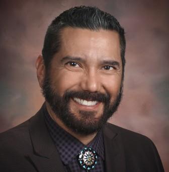 APS school board member and actor Steven Michael Quezada.