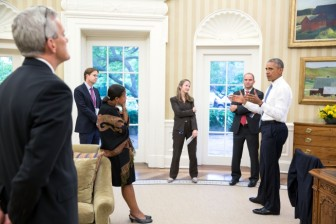 President Barack Obama talks with national security staff in the Oval Office after being notified of the nuclear agreement with Iran on July 13. Photo Credit: Pete Souza, White House
