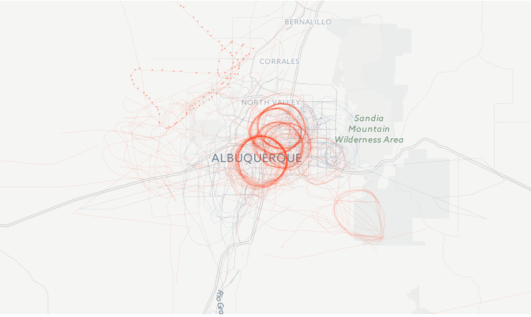 Flight paths of FBI planes that flew over the Albuquerque metro area through December, 2015. The darker red areas indicate more flights. Screenshot of Buzzfeed map.