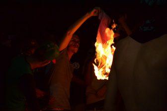 A protester burning a Donald Trump t-shirt outside the Albuquerque Convention Center.