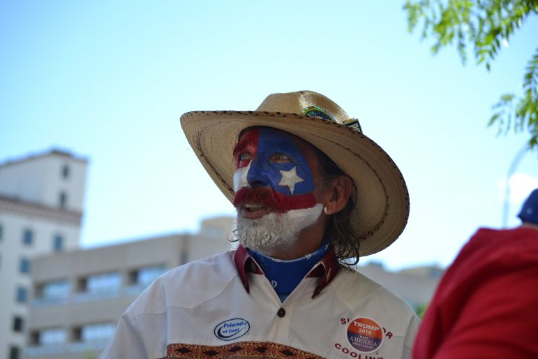 A Donald Trump supporter with face paint