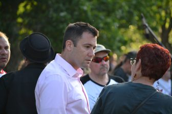 Albuquerque City Councilor Pat Davis speaking to a constituent at an Albuquerque vigil for victims of attack on an Orlando LGBT nightclub.