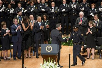 Dallas Mayor Mike Rawlings welcomes Dallas Chief of Police David Brown to the podium as the Bushs and the Obamas look on at the interfaith police memorial at the Morton Meyerson Symphony Center in Dallas on July 12, 2016.