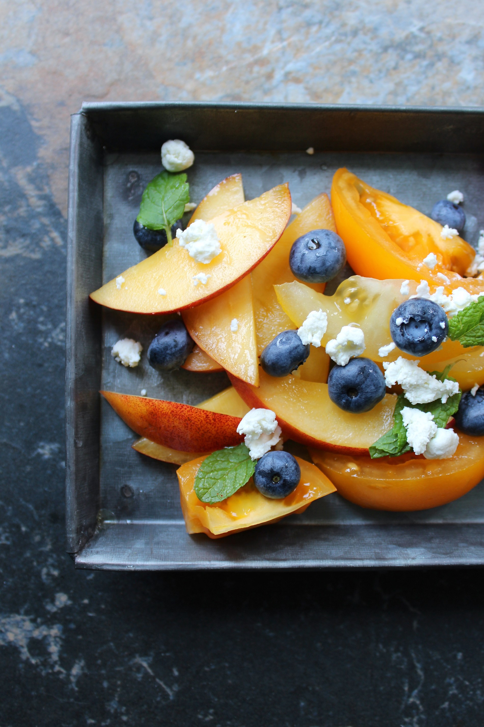 Blueberry, Tomato, Nectarine Salad with fresh mint and goat cheese